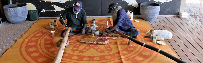 Painting the yidaki (didgeridoo) at Anindilyakwa Arts Centre Groote Eylandt